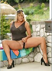 Happy bombshell Debi Diamond posing in hot lingerie and fingering outdoors