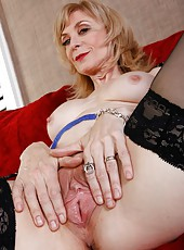 Cheeky slut Nina Hartley spreading mature pussy and masturbating hard