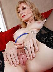 Cheeky slut Nina Hartley spreading mature pussy and masturbating hard