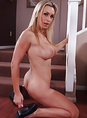Nice hooker Tanya Tate stripping fully naked and rubbing her big butt