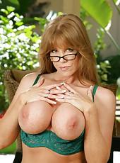 Chubby pornstar Darla Crane stripping in lingerie and rubbing boobies