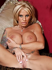 Goodly chick Olivia loves showing her tattooes and playing with pussy