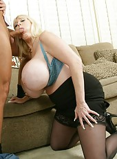 Big-titted pornstar Kayla Kleevage banging with her neighbor on the sofa