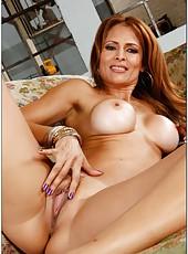 Splendid pornstar Monique Fuentes lying on the sofa and fingering