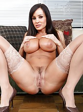 Wild minx Lisa Ann posing without clothes and spreading her tight asshole