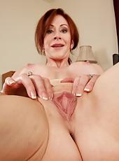Exquisite housewife Catherine de Sade spreading wet vagina on camera