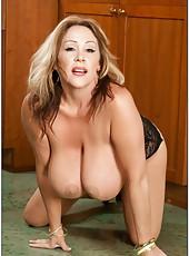 Beautiful mature Kandi Cox playing with big tits and reaching satisfaction