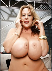 Beautiful mature Kandi Cox playing with big tits and reaching satisfaction