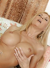 Attractive babe Brooke Tyler showing tattooes and fingering snatch