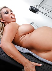 Foxy bitch Holly Halston posing on camera and spreading her asshole