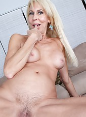 Dreamy mature Erica Lauren rubbing big tits and playing with tight sissy
