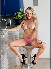 Yummy housewife Brandi Love prefers posing and fingering shaved vagina