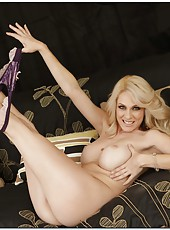 Spoiled pornstar Angela Attison wearing sexy lingerie and fingering