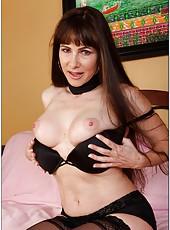 Sparkling whore Alexandra Silk taking off stockings and masturbating