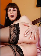 Sparkling whore Alexandra Silk taking off stockings and masturbating