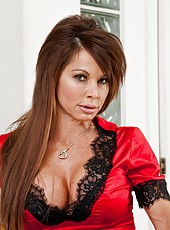 Erotic mature Jenla Moore showing big tits and fingering for the audience
