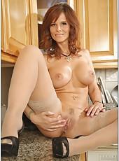 Arrogant hooker demonstrating her skills and fingering at the kitchen