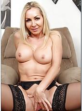 Glamorous milf Lisa Demarco showing big tits and jilling shaved axilla