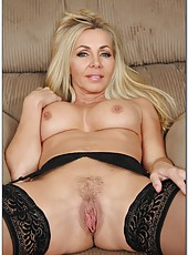 Glamorous milf Lisa Demarco showing big tits and jilling shaved axilla