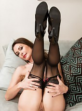 Ardent babe Nora Noir demonstrating big round ass and fingering