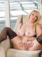 Perfect housewife Charlee Chase demonstrates big tits and poses on camera