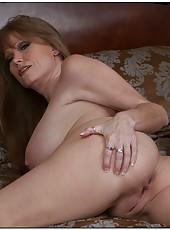 Playful mature Darla Crane revealing big boobs and jilling tight sissy