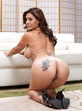 Entrancing milf Raylene showing tattooes and getting naked in her house