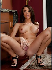 Lingerie milf model Chanel Preston is showing her shaved pussy