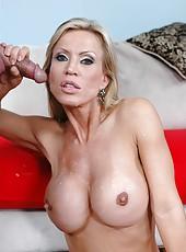 Seducing big tits milf Amber Lynn is sucking hard cock of her lover
