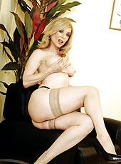 Superb milf blondie Nina Hartley is spreading her legs in sexy lingerie