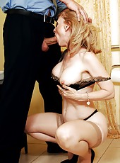 Superb milf blondie Nina Hartley is spreading her legs in sexy lingerie