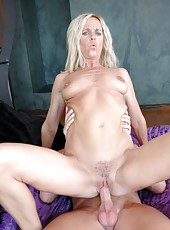 Beautiful milf blondie Totally Tabitha is doing hot striptease show