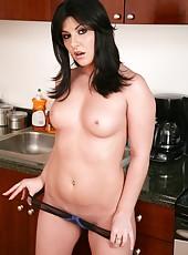 Attractive woman Taryn Thomas masturbating in kitchen and making a blowjob
