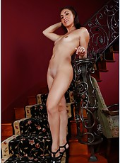 Spicy milf Kimberly Kasanova posing and fucking with her husband on stairs