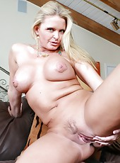 Cocky mature Maya Divine taking off jeans and enjoying a yummy pecker