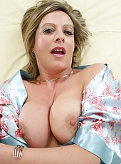 Blonde MILF Silky Thighs Lou wearing stocking and playing with dildo