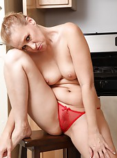 Marvelous and horny slut Tracey Lain posing naked in the kitchen