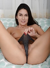 Natural MILF Nikki Daniels wearing fishnet clothes and spreading her legs