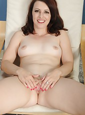 Winsome MILF Violet showing her creamy-skinned body and her wet cunt