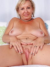 Remarkable mature whore Nicole spreading her legs and showing her tattoo