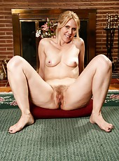 Appealing blonde whore Trish prefers to spread her legs on the floor