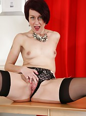 Arresting mature slut Penny Brooks taking off her lingerie very slow