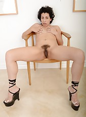 Foxy MILF Kinky Gaga spreading her legs and showing her hairy twat
