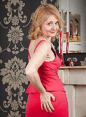 Stunning MILF Isabella taking of her red dress and showing her boobs