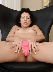 Pretty mature brunette Kinky Gaga showing her hairy pussy and her nice tits