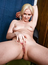 Seductive blonde MILF knows how to stand to make ones cock even harder