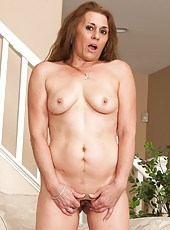 Foxy MILF Cristine Ruby likes to show off her nice body and her sweet boobs