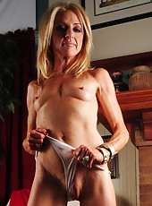 Beautiful MILF Ava taking off her red dress and showing her shaved cunt