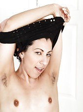 Topnotch mature slut Kinky Gaga showing her hairy cunt and masturbating