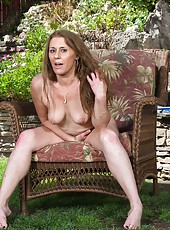 Mature slut Cristine Ruby showing her body naked while being outdoors